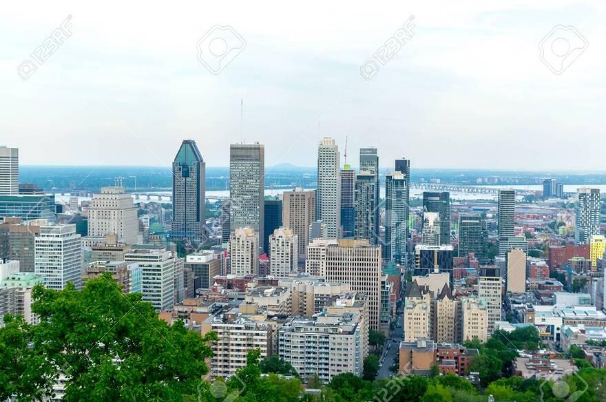 Image: https://previews.123rf.com/images/bakerjarvis/bakerjarvis1806/bakerjarvis180600001/102955106-montreal-skyline-in-summer-canada.jpg