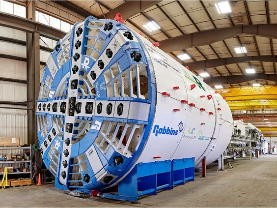 The tunnel boring machine is 100 metres long and includes several specialized machines a belt conveyor a cockpit and about 10 workers inside