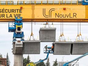 Construction of the REM along Highway 40 at Sources Blvd. in Dollard-des-Ormeaux Sept. 24, 2020.