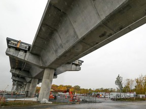 MONTREAL, QUE.: OCTOBER 16, 2020 -- Constrcution continues on the REM station at the corner of the Highway 40 service road and Faiview Ave. in Pointe Claire, west of Montreal Friday October 16, 2020. Cadillac Fairview plans to build a massive development west of Fairview Ave. and the Fairview Pointe Claire shopping centre and near the REM station. (John Mahoney / MONTREAL GAZETTE) ORG XMIT: 65156 - 9282
